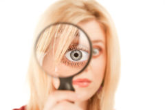 Pretty Blonde Woman with Magnifying Glass Royalty Free Stock Image