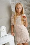 Pretty blonde in mini dress Royalty Free Stock Photos