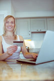 Pretty blonde woman ordering online. At home Royalty Free Stock Images
