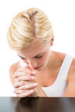 Pretty blonde woman praying Stock Image