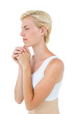 Pretty blonde woman praying Stock Photography