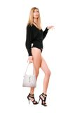 Pretty blonde woman with the purse royalty free stock photography