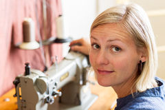 Pretty Blonde Woman At Sewing Machine Royalty Free Stock Photo