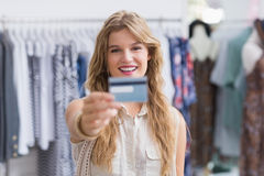 A pretty blonde woman showing her credit cards Stock Images
