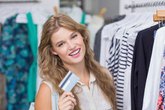 A pretty blonde woman showing her credit cards Royalty Free Stock Images