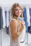 A pretty blonde woman showing her credit cards Royalty Free Stock Photo