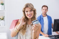 A pretty blonde woman showing her credit cards Royalty Free Stock Photography