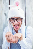 Pretty blonde woman smiling at the camera wearing funny hat Stock Images