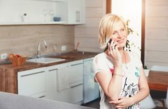 Pretty Blonde Woman Speaking On The Smartphone stock image