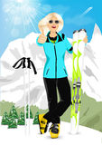 Pretty blonde woman standing with mountain skis Royalty Free Stock Images
