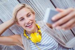 Pretty blonde woman taking selfie Stock Photography