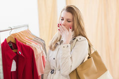 Pretty blonde woman tired during shopping Royalty Free Stock Photo