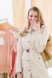 Pretty blonde woman tired during shopping Royalty Free Stock Photography
