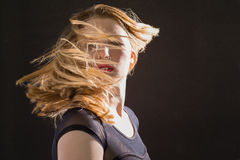 Pretty blonde woman tossing hair Royalty Free Stock Photo