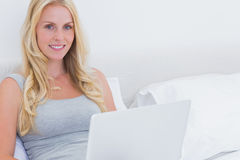 Pretty blonde woman using her laptop Stock Photos