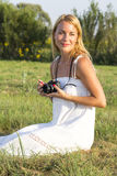 Pretty blonde woman with vintage photo camera Stock Image