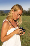Pretty blonde woman with vintage photo camera Royalty Free Stock Image