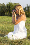Pretty blonde woman with vintage photo camera Royalty Free Stock Photography