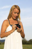Pretty blonde woman with vintage photo camera Stock Photo