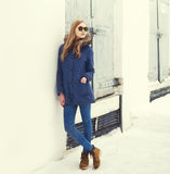 Pretty blonde woman wearing a jacket and sunglasses Royalty Free Stock Photos