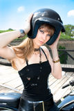 A pretty blonde woman wearing a  motorcycle helmet Stock Image
