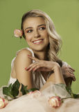 Pretty blonde woman wearing pink makeup and nail polish Stock Image