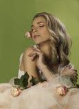 Pretty blonde woman wearing pink makeup and nail polish Stock Photo