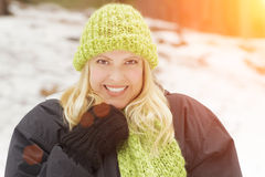 Pretty Blonde Woman Wearing Scarf and Hat in the Snow Stock Photo