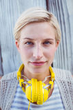 Pretty blonde woman wearing yellow headset Stock Images