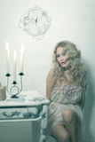 Pretty blonde woman in a white interior. Vintage cold colors with soft effect stock photo