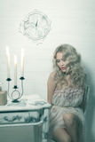 Pretty blonde woman in a white interior. Vintage cold colors with soft effect stock images