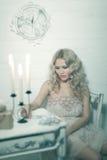 Pretty blonde woman in a white interior Stock Photos