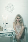 Pretty blonde woman in a white interior Royalty Free Stock Images