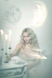 Pretty blonde woman in a white interior Stock Image