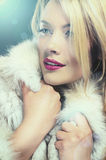 Pretty blonde woman in winter coat Royalty Free Stock Images