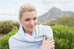 Pretty blonde wrapped up in blanket outside Royalty Free Stock Image