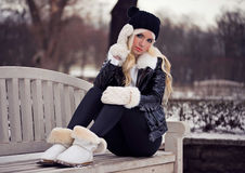 Pretty blonde young girl in posing outdoors Stock Photo