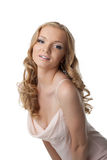 Pretty blonde young woman in dress Stock Photography