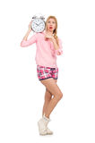 The pretty blondie girl holding alarm-clock isolated on white Royalty Free Stock Image