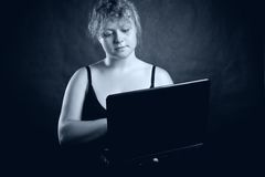 Pretty blondie with laptop Royalty Free Stock Images