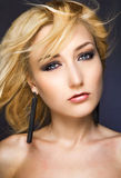 Pretty blondy woman. With long earrings Stock Image