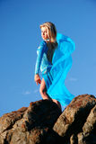Pretty in Blue. Model dancer in blue against blue sky Stock Image