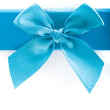 Pretty blue bow and ribbon on a gift box lid. Close up of a pretty turquoise blue bow and ribbon on a gift box lid isolated on white with copyspace for your Stock Photo