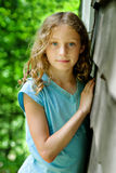 Pretty blue eyed girl. Pretty girl standing outdoors looking at the camera Royalty Free Stock Image