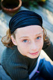 Pretty blue eyed girl. Pretty girl looking up into the camera with beautiful blue eyes Royalty Free Stock Photos