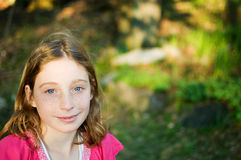 Pretty blue eyed girl. Beautiful blond blue eyed twelve year old girl outdoors in the summer sun Royalty Free Stock Photos
