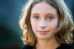 Pretty blue eyed girl. Twelve year old blond, blue eyed girl looking at the camera Royalty Free Stock Photo