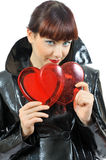 Pretty blue-eyed girl with two hearts in hands. Isolated on white Royalty Free Stock Photography