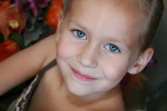 Pretty Blue Eyes. Young girl with blue eyes smiles sweetly Royalty Free Stock Photos