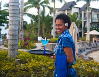 Pretty in Blue at Radisson Blu. A waitress, pretty in blue, with an iconic Blu Cocktail at the Radisson Blu, Fiji Islands stock photo